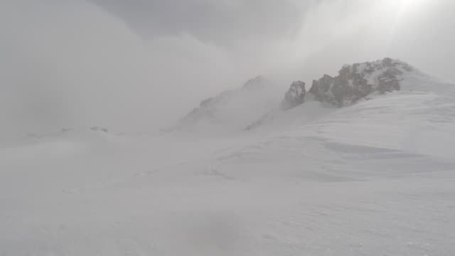 view of blizzard winds landscape  snow with mountains - snow storm stock videos and b-roll footage