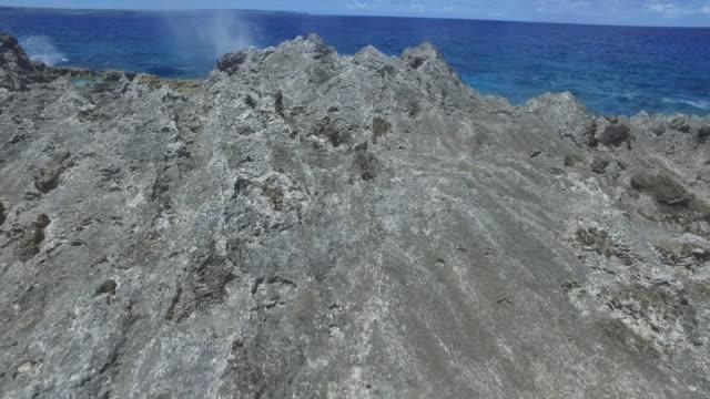 vídeos y material grabado en eventos de stock de view of blowhole which is natural fountain in beach of tinian, northern mariana islands - tinian
