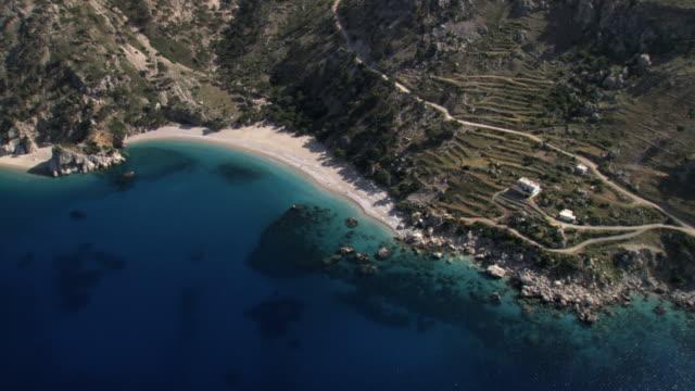 AERIAL WS DS View of blue beach of Karpathos Island / Karpathos, Dodecanese Islands, Greece