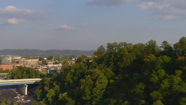 WS AERIAL View of Blue Cross Blue Shield of Tennessee office building then reveal of AT and T Field (baseball stadium) and buildings of downtown / Chattanooga, Tennessee, United States