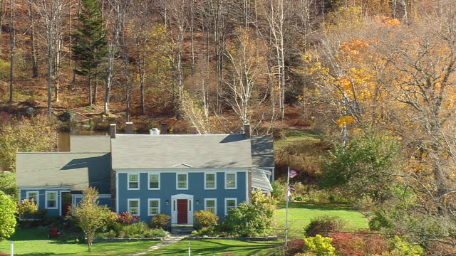 ms aerial zi view of blueberry hill inn surrounded by trees / vermont, united states - inn stock videos and b-roll footage