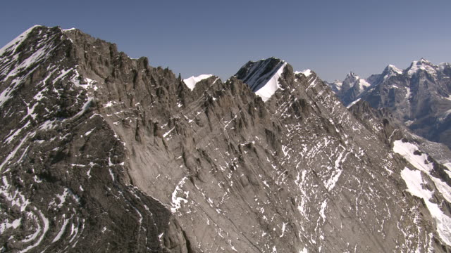ws aerial view of bluemlisalp summit ridge and bluemlisalphorn, wyssi frau with morgenhorn kanderfirn and tschingelfirn / bluemlisalp, bern, switzerland - frau stock videos & royalty-free footage