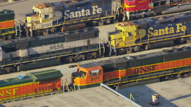 ms aerial view of bnsf engine cars on tracks / topeka, kansas, united states - shunting yard stock videos and b-roll footage