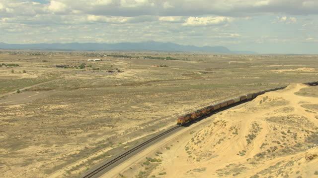 ws zi aerial view of bnsf train through dry and flat land in pueblo country / colorado, united states - pueblo colorado stock videos & royalty-free footage