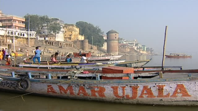 view of boat anchored in front of the tulsi ghat in varanasi - anchored stock videos & royalty-free footage