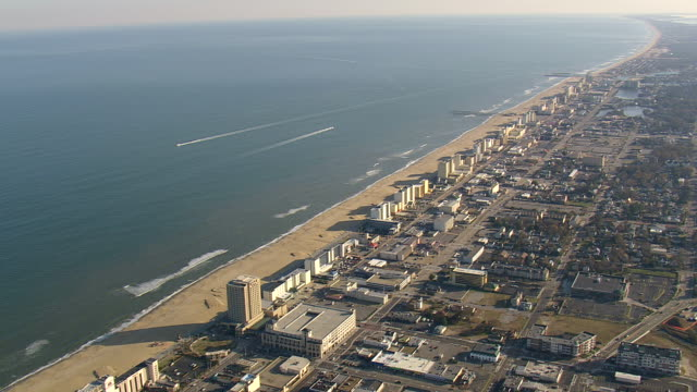 ws aerial zi view of boat at beach  / virginia, united states - virginia beach stock videos & royalty-free footage
