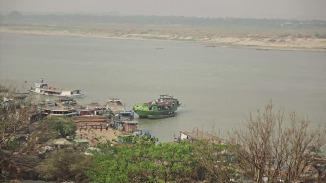 ws view of boat houses and other boats near the shore  / mandalay, mandalay division, myanmar - mandalay stock videos and b-roll footage