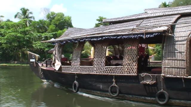 ms pan view of boat in backwaters of kerala / kerala, india - backwater stock videos & royalty-free footage