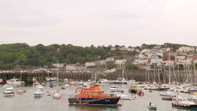 ws pan view of boat mooring area / st. peter port, guernsey, united kingdom - guernsey stock videos & royalty-free footage
