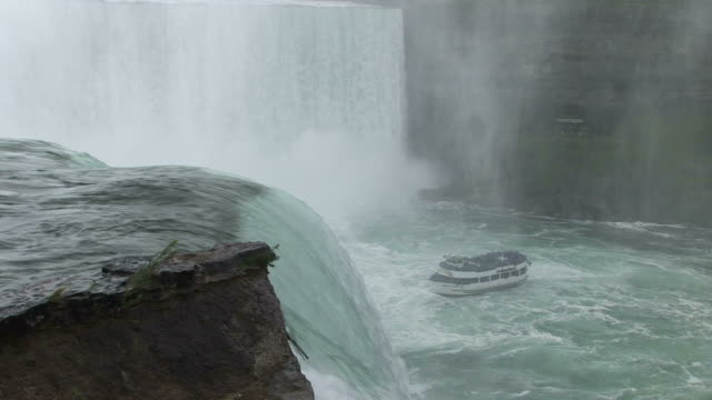 view of boat near niagara fall in new york united states - fluss niagara river stock-videos und b-roll-filmmaterial