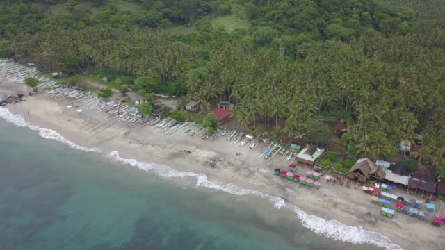 view of boats and sea waves in karangasem regency / bali, indonesia - naturligt landmärke bildbanksvideor och videomaterial från bakom kulisserna