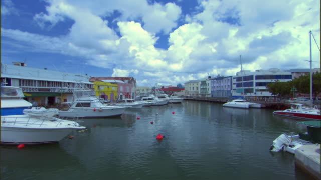 ws view of boats moored on harbor / bridgetown, st michael, barbados - 天使ミカエル点の映像素材/bロール