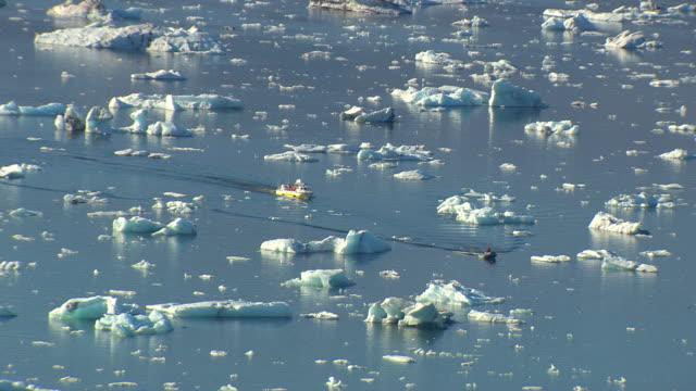 WS AERIAL ZI ZO View of boats moving among Jokulsarlon icebergs / Iceland