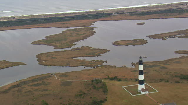 ws aerial zo view of bodie island and lighthouse / north carolina, united states - north carolina beach stock videos & royalty-free footage