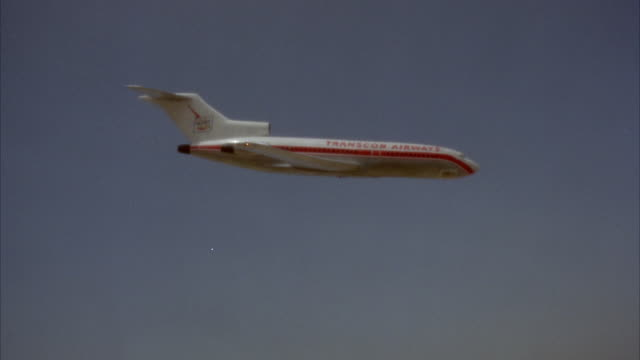 ws view of boeing 727 with red stripe on airplane flying - air to air shot stock videos & royalty-free footage