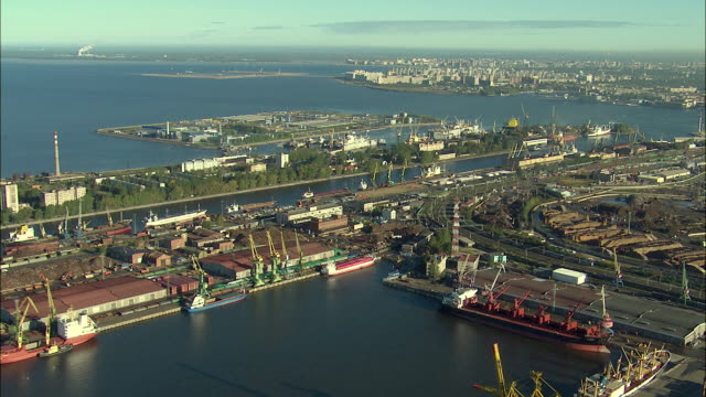 WS POV AERIAL View of Bolshoi cargo seaport and St Petersburg cityscape / Saint Petersburg City, Saint Petersburg, Russia