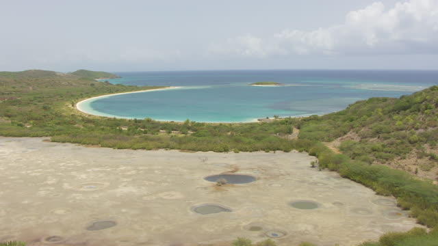 WS AERIAL POV View of bomb craters with lagoon / Vieques, Puerto Rico, United States