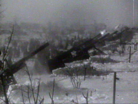 ms view of bombardments cannon and dead bodies covered by snow audio / russia - anno 1941 video stock e b–roll