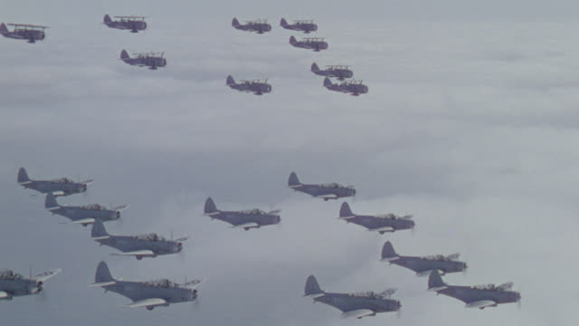 ws aerial view of bombers and bi planes trainers in flight - formationsfliegen stock-videos und b-roll-filmmaterial