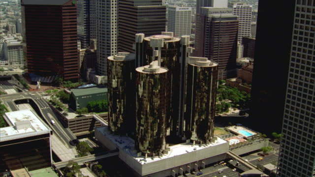 WS POV AERIAL View of Bonaventure hotel towers / Los Angeles, California, USA