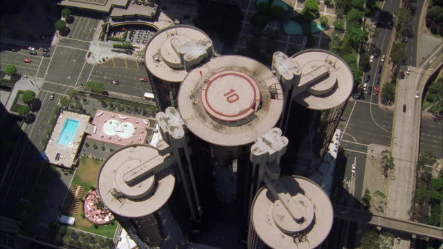 ws pov aerial view of bonaventure hotel towers with cityscape / los angeles, california, usa  - number 10 stock videos & royalty-free footage