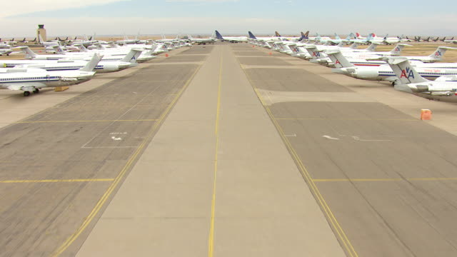 ws aerial tu view of bone yard of parked commercial jet airliners / roswell, new mexico, united states - roswell stock videos & royalty-free footage