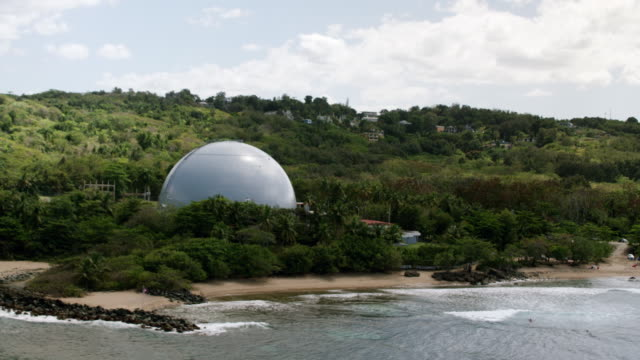 WS AERIAL POV View of BONUS Nuclear Reactor, Domes Beach in foreground / Rincon, Puerto Rico, United States