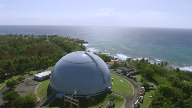 ws aerial pov view of bonus nuclear reactor, domes beach in foreground / rincon, puerto rico, united states  - nuclear reactor stock videos & royalty-free footage