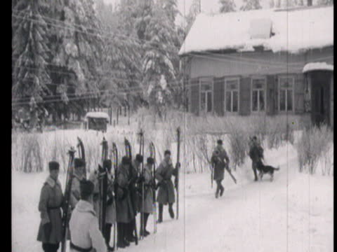 View of border guards in winter with drills using skis and German shepherd dogs to trace spies / Russia AUDIO