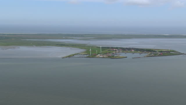 ws aerial pan view of borkum island in north sea / borkum, lower saxony - küste stock-videos und b-roll-filmmaterial