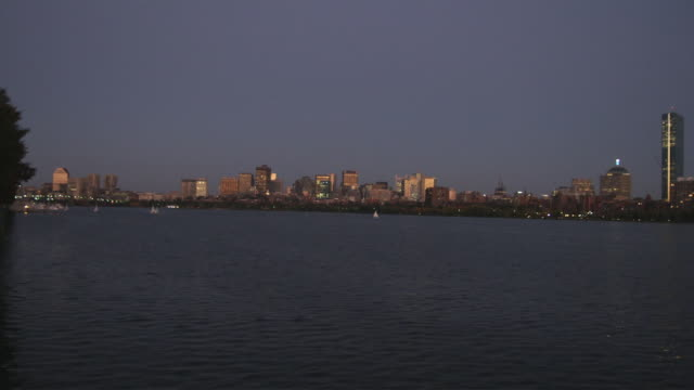 ws view of boston from charles river at night / boston, massachusetts, usa - river charles stock videos & royalty-free footage
