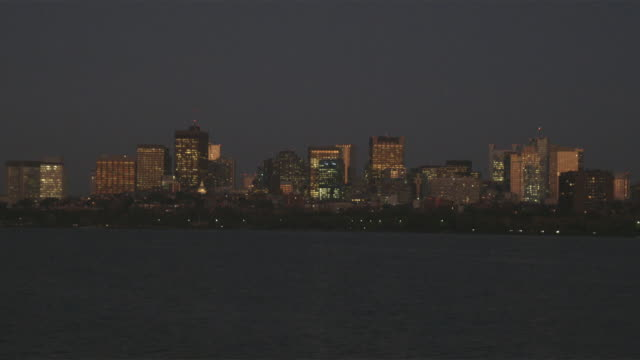 ws view of boston from charles river at night / boston, massachusetts, usa - charles river stock videos & royalty-free footage