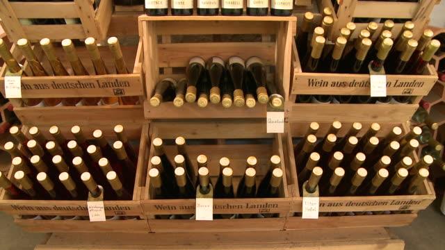 vidéos et rushes de  ms tu view of bottles at brandy distillery / fellerich, rhineland-palatinate, germany  - bouteille de vin