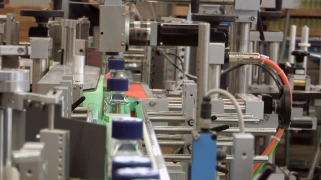ms view of bottles on factory production line / dusseldorf, germany - labelling stock videos & royalty-free footage