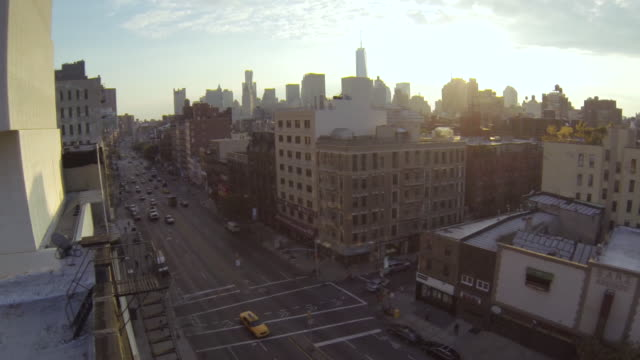 ws aerial slo mo view of bowery street with buildings and vehicles moving on road / new york, united states - urban road stock videos & royalty-free footage