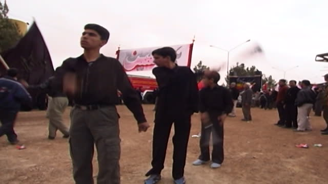 view of boys performing azadari rituals during ashura ashura the tenth day of the islamic month of muharram commemorates the death of hussain ibn ali... - ashura muharram stock videos & royalty-free footage