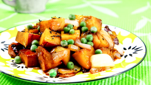 view of braised sweet potato with pea on top (popular korean side dish) - sweet potato stock videos & royalty-free footage