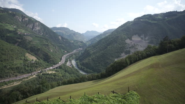 ws pov view of brenner autobahn with mountains in italy - brennero stock videos and b-roll footage