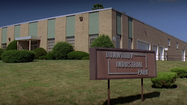 ws view of brick office building with 'dunwoody industrial park' sign in foreground / georgia, usa - placard stock videos & royalty-free footage