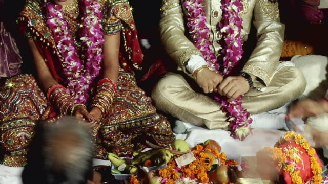 MS View of bride and groom at their wedding / New Delhi City, New Delhi, India