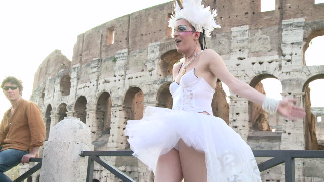 MS View of bride standing in front of coliseum AUDIO / Rome Lazio Italy