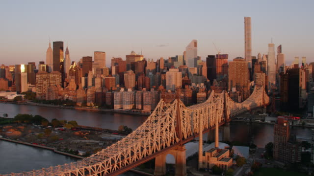 AERIAL MS View of bridge and city at morning / New York City