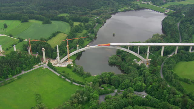 ws aerial view of bridge construction / germany - ponte video stock e b–roll