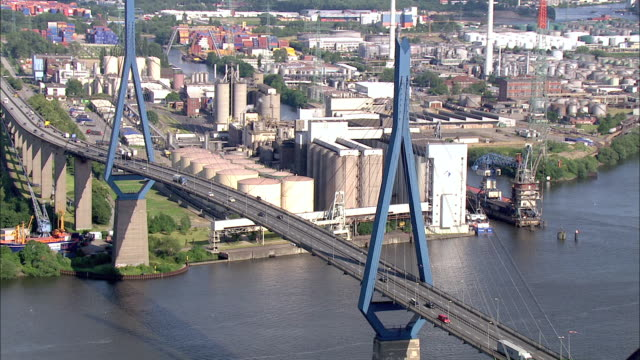 aerial ws ds view of bridge near container terminal / hamburg, hamburg, germany - brücke stock-videos und b-roll-filmmaterial