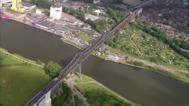 aerial ws view of bridge on river/ kiel canal, schleswig-holstein, germany - schleswig holstein stock-videos und b-roll-filmmaterial