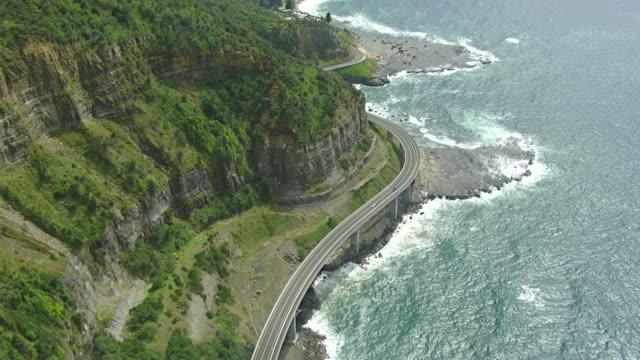 vídeos y material grabado en eventos de stock de ws aerial view of bridge on sea coast / newcastle, new south wales, australia - newcastle