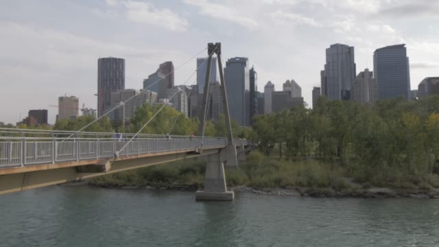 View of bridge over Bow River, Prince???s Island Park and Downtown skyline from Sunnyside, Calgary, Alberta, Canada, North America
