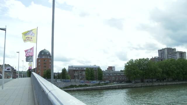 stockvideo's en b-roll-footage met ws pan view of bridge over meuse river in liege / liege, wallonia, belgium - luik architectonisch element