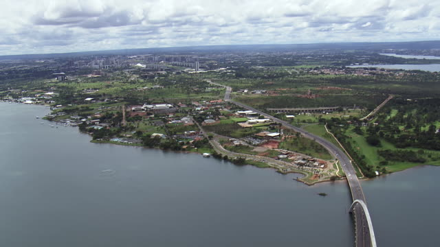 ws aerial td view of bridge over river / brasilia, brazil - juscelino kubitschek bridge stock videos & royalty-free footage