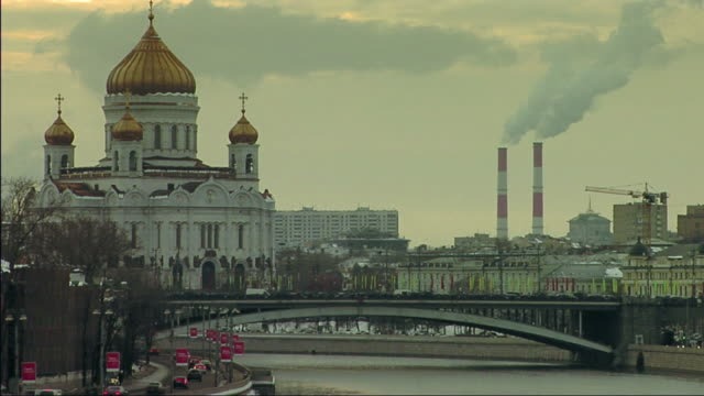 ws view of bridge over river, church and smoke stack in background / moscow, russia - moscow russia video stock e b–roll
